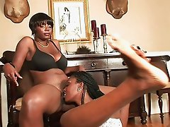 Ebony babes share one dildo