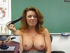 Horny MILF teacher toys her wet muf