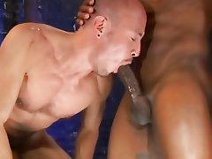A bald man takes big black cock deeply into his white back door