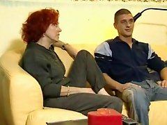 Mature redhead fucked by a youn guy