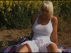 Short haired blonde momma with large melons fingers her pussy outdoor