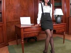 Secretary showing her feet and masturbating