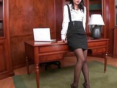 Secretary showing her feet and masturbating