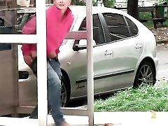 Pretty girl taking a piss on a public street