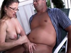 Mature tugging cock outdoors while in spex