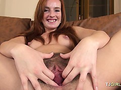 Redhead plays with blow-up sex toy