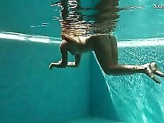 Russian girl in her bikini has fun stripping and swimming