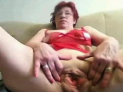 Asian amateur granny toys her cunt