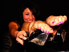 Enticing brunette with a cute smile exposes her sexy feet