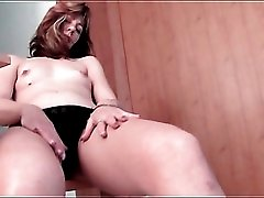 Tiny tits milf in pantyhose in her kitchen