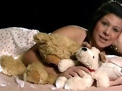 Chubby retro brunette girl plays naughty with teddy toy and pussy