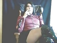 Tranny in latex boots smokes and jerks off