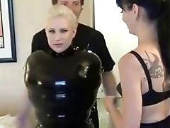 Bondage skank in rubber teased by lesbian slut BDSM porn