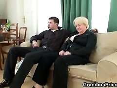 Granny threesome with young men
