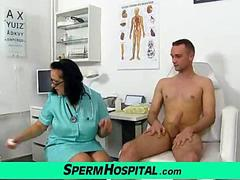 A boy receives a handjob from busty madam Danielle