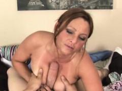 Mature cougar tugs him until her cums