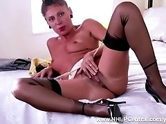 Sexy French Milf Chloe is horny in the bedroom stripping down to her gartered nylons vintage and masturbates hairy wet pussy