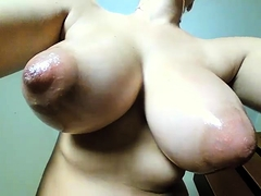 Buxom lady with huge nipples indulges in intense fingering