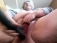 Fat amateur nympho drills her aching snatch with a big toy