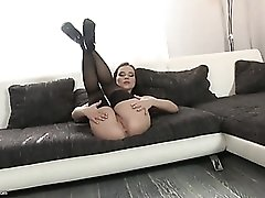 Booty shaking brunette in sexy black stockings