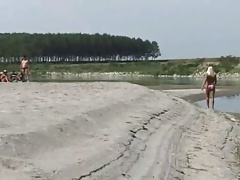 Wife teasing a Strangers on a Beach