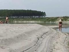 Wife teasing a Strangers on a Beach