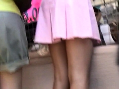 Desirable amateur girl with fabulous legs upskirt outside