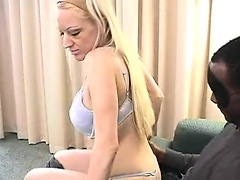 Attractive hot blonde girl with dark man enjoying sex and