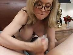 Nerdy blonde momma with glasses sucking meaty knob