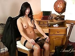 Seriously hot mom masturbates in fishnets