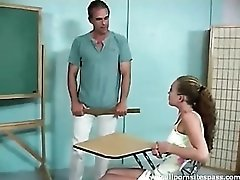 Curly haired teen gets spanked in the classroom