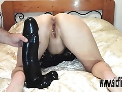 Fisting and colossal dildo fucking his slut wife