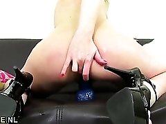 Big blue dildo fucks up into her slutty milf pussy