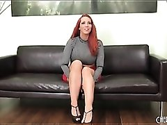 Kelly Divine is sexy in a skirt and tight top