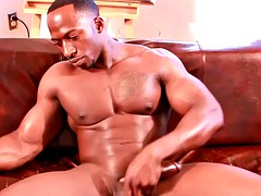 beefy black hunk tugging his big cock