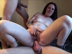 Slutty brunette wife has two guys fucking her hungry holes