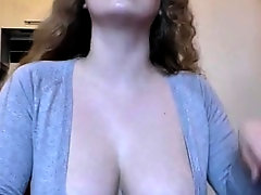 curly hair with huge tits cleaning the desk