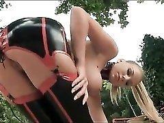 Pornstar Danielle Maye models black latex outdoors