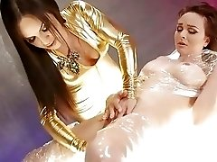 Mesmerizing girl tied up and then stimulated by a shemale