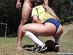 Brazilian blows him outdoors on a sunny day