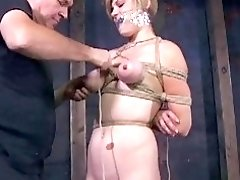 Awesome blonde gets her tits squeezed hard in BDSM scene