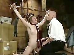 Girl throat fucked and flogged by master in BDSM movie