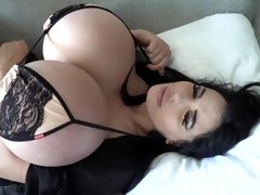Alluring slut with enormous melons poses alone on the bed
